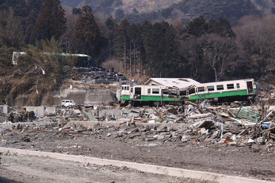 Damaged train and debris carried by tsunami