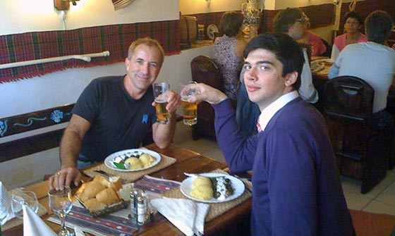 Ovidiu and I enjoy an Ursus (Bear) beer and lunch consisting of polenta with pork wrapped in grape leaves.