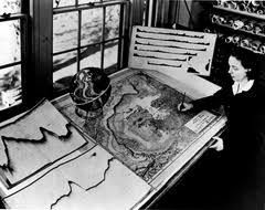 A staged photo of a young Marie (late 1950s) with her map, and the depth profiles from which she got her map details shown on the left
