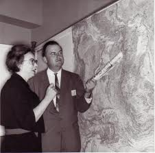 Marie and her partner Bruce Heezen in the early 1960s, looking at their recently completed map of the Atlantic seafloor