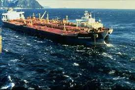 The Exxon Valdez leaking oil from Bligh Reef