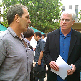 "Evolutionary psychologists Steven Gangestad and David Buss chat during one of the breaks between talks. Gangestad spoke on: ""Men's Facial Masculinity, but Not Their Intelligence, Predicts Changes in Their Female partners' Sexual Interests Across the Ovulatory Cycle"" (see summary in the text), while David Buss spoke on: ""Sexual Double Standards: The Evolution of Moral Hypocrisy"" (see summary in the text)."