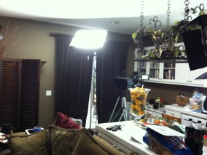 "The ""soundstage"" of Mr. Deity: cameras and lights crammed into the kitchen, shooting into the living room"