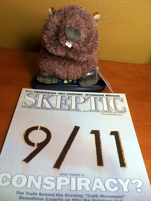 wombat reading Skeptic magazine